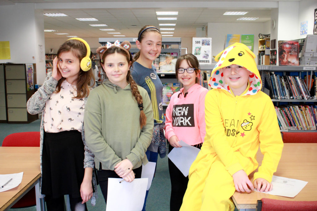 Children in Need: Students in the school library taking part in 'find the hidden Pudsey's' game.