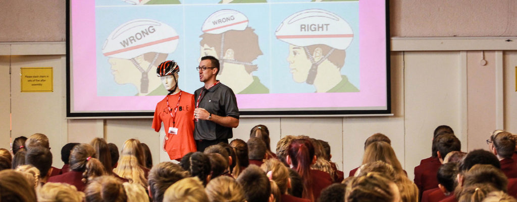 Road safety demonstration on how to wear a helmet correctly