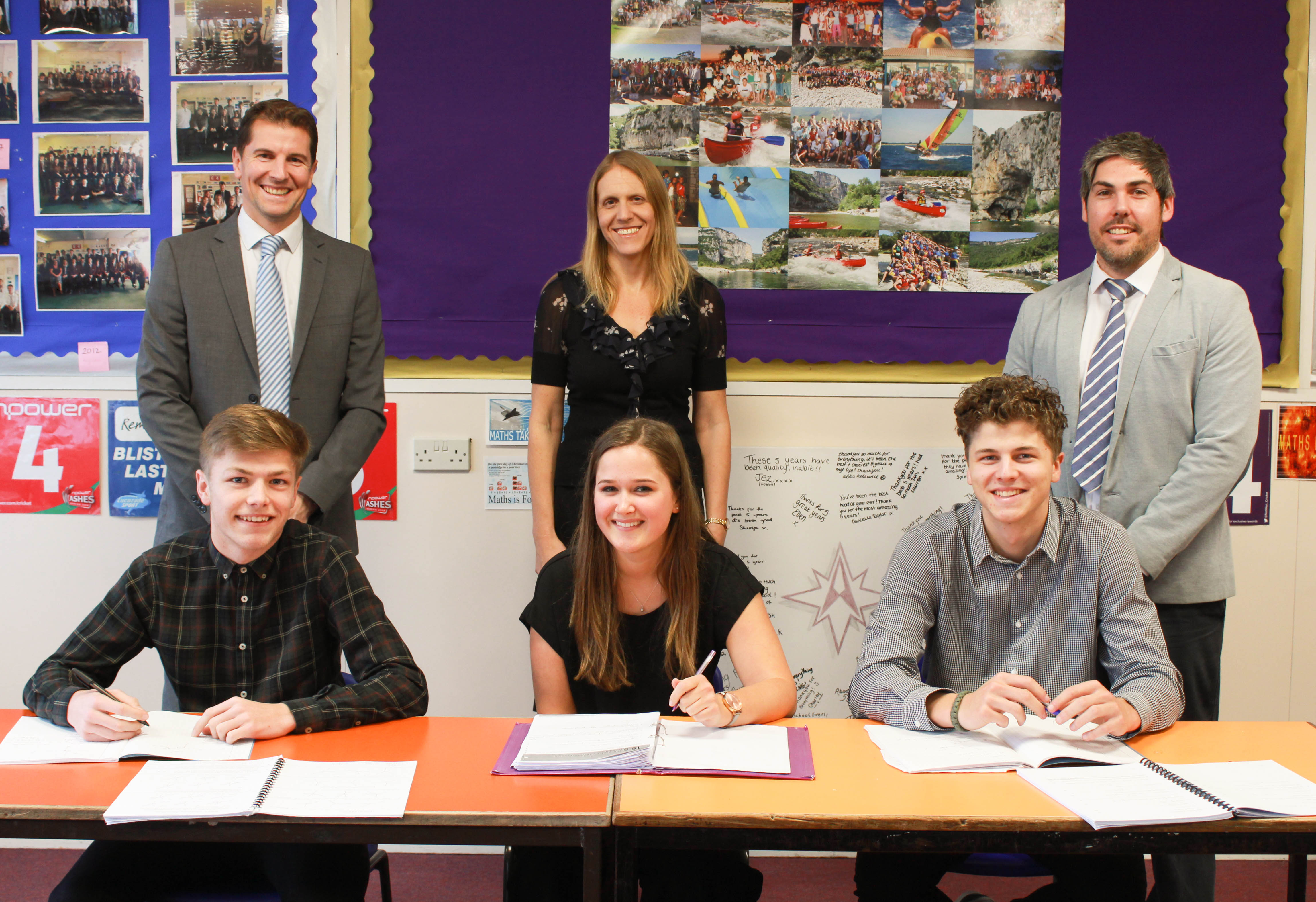 Mr Colman, Mrs Nation, Mr King and students celebrate being recognised for outstanding results
