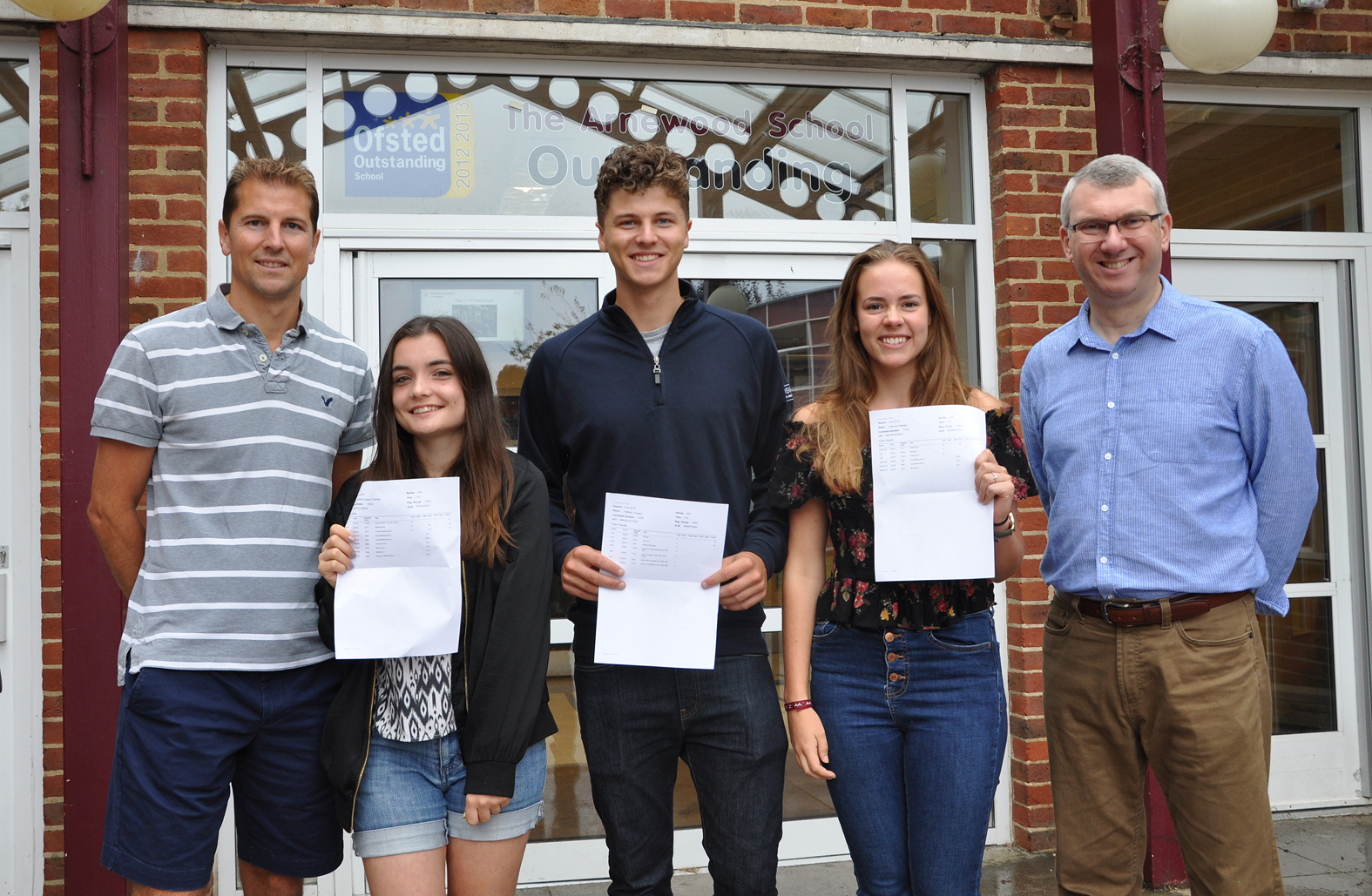 Head of Sixth Form and Arnewood Headteacher celebrate A-level Results with students