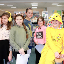 Students in the school library taking part in 'find the hidden Pudsey's' for Children in Need
