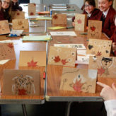 Y7 students with their Hygge cards that they created at the Y7 Arts Festival.