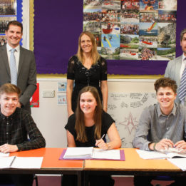 Mr Colman, Mrs Nation, Mr King and students celebrate reaching the top of the summit in its A level results